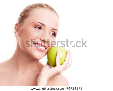 portrait of a happy beautiful woman  holding an apple, isolated against white background
