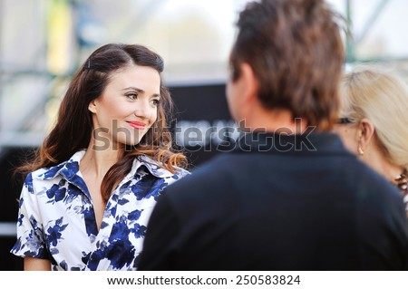portrait of a happy beautiful woman with red lips communicates with people. - stock photo