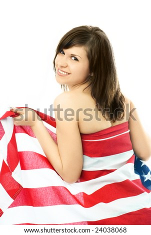 portrait of a happy beautiful young nude woman wrapped into the American flag