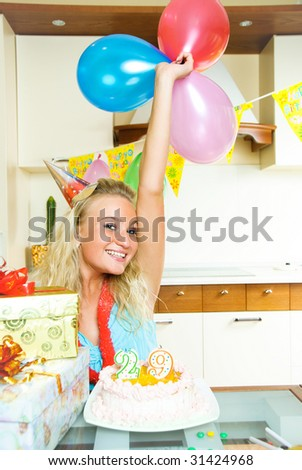 portrait of a happy blond girl celebrating birthday