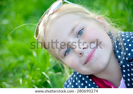 Portrait of a happy blond girl close-up - stock photo