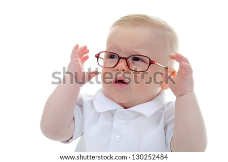 Portrait of a happy blue-eyed child boy with glasses. Isolated on white background - stock photo