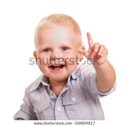 Portrait of a happy boy in a bright shirt with a raised hand isolated on white background.