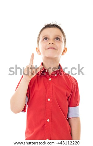 Portrait of a happy boy pointing up over white background - stock photo