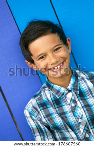 Portrait of a happy boy with bright background. - stock photo