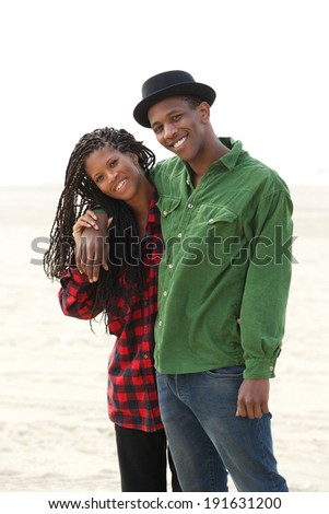 Portrait of a happy brother and sister smiling outdoors - stock photo