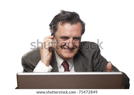 Portrait of a happy business man with a laptop isolated on white background talking on the mobile phone