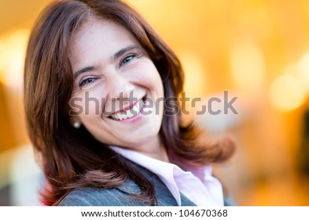 Portrait of a happy business woman smiling - stock photo