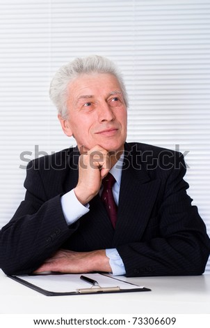 Portrait of a happy businessman on a white background