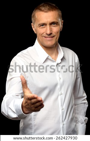 Portrait of a happy businessman posing on background - stock photo