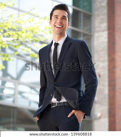 Portrait of a happy businessman walking to work - stock photo