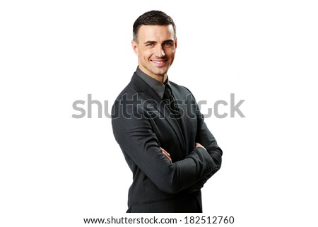 Portrait of a happy businessman with arms folded isolated on a white background - stock photo