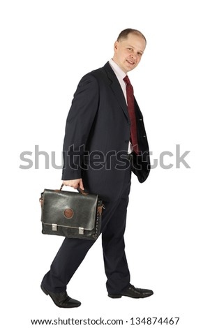 portrait of a happy businessman with briefcase in hand, isolated on white background
