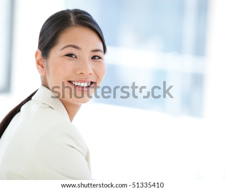 Portrait of a happy businesswoman at work - stock photo