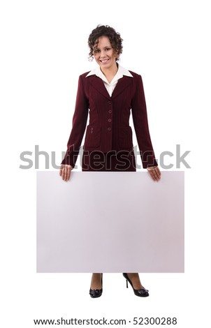 Portrait of a happy businesswoman holding white blank card against isolated white background. A beautiful young woman is holding a blank white sign. Business woman standing beside a billboard - stock photo