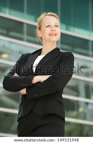 Portrait of a happy businesswoman smiling outdoors