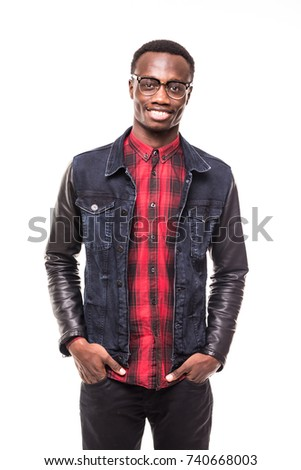 Portrait of a happy casual afro American man standing with hands in pocket in studio on white isolated