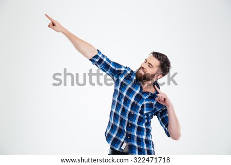 Portrait of a happy casual man posing isolated on a white background - stock photo