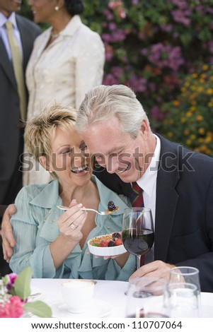 Portrait of a happy Caucasian couple sitting together for a brunch