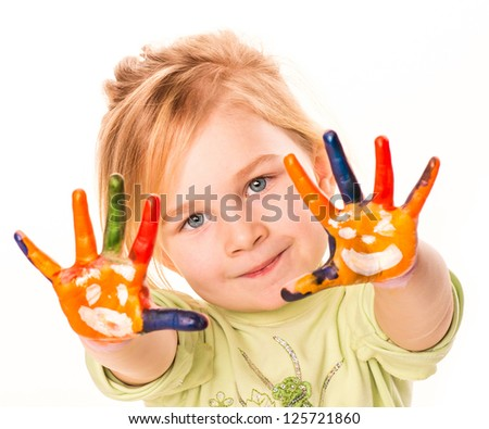Portrait of a happy cheerful child showing her hands painted in bright colors, isolated over white - stock photo