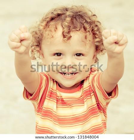 portrait of a happy child - stock photo