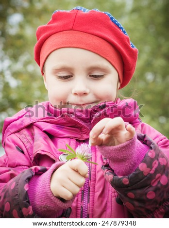 Portrait of a happy child close-up with flower. - stock photo
