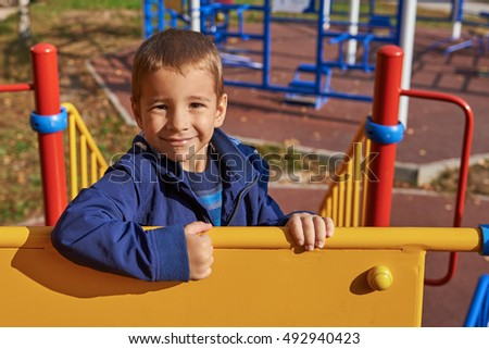 Portrait of a happy child on the playground