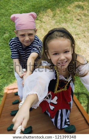Portrait of a happy children hanging on a rope