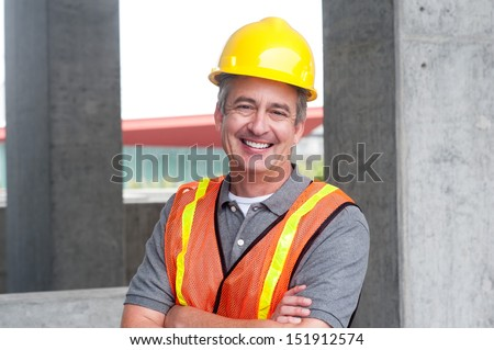 portrait of a happy construction worker shot outside - stock photo
