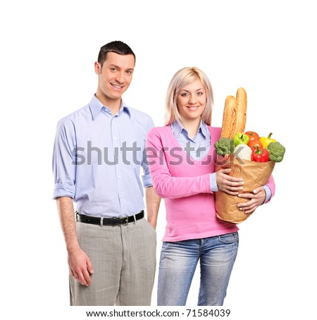 Portrait of a happy couple after shopping at the market isolated on white background