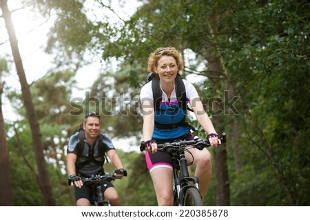 Portrait of a happy couple enjoying a bike ride in nature