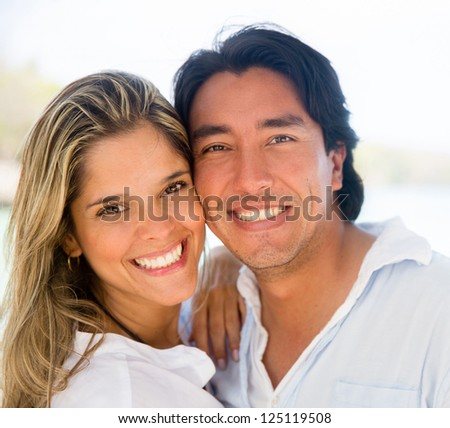 Portrait of a happy couple enjoying their holidays - stock photo