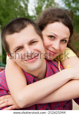 Portrait of a happy couple laughing at camera - stock photo