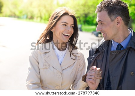 Portrait of a happy couple walking outdoors - stock photo