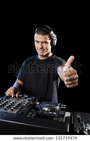 Portrait of a happy DJ with thumbs up
