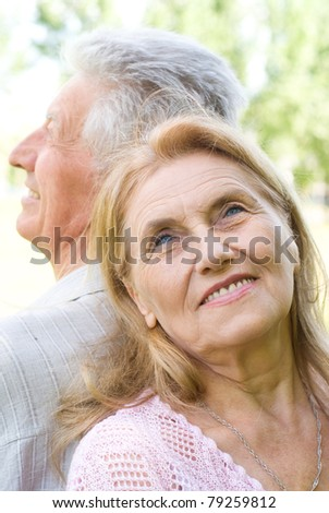 portrait of a happy elderly couple at nature