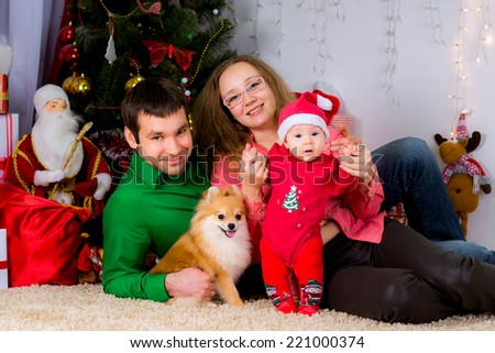 Portrait of a happy family and the dog spending together  Christmas time at home near the Christmas tree New year concept - stock photo
