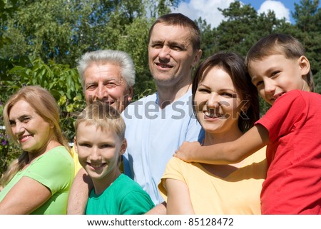 portrait of a happy family at nature
