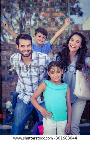 Portrait of a happy family having fun in the mall on a sunny day - stock photo