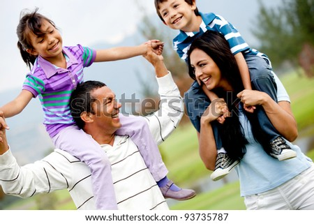 Portrait of a happy family having fun outdoors - stock photo