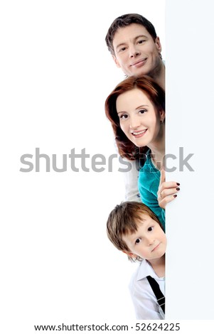 Portrait of a happy family looking out of a billboard. Isolated over white background. - stock photo