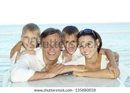 portrait of a happy family of four on a summer holiday