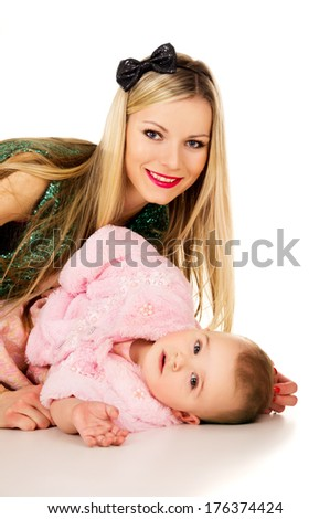 Portrait of a happy family of mother and child - stock photo