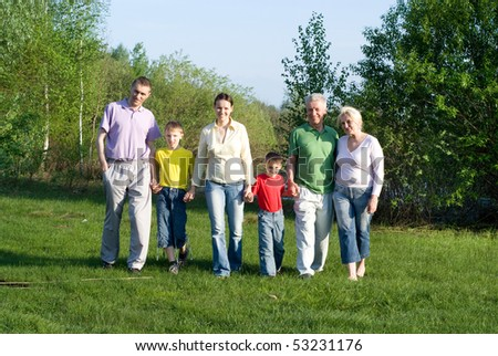 portrait of a happy family of six on the nature - stock photo