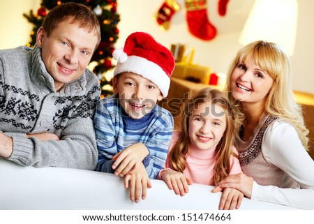 Portrait of a happy family on a Christmas eve - stock photo