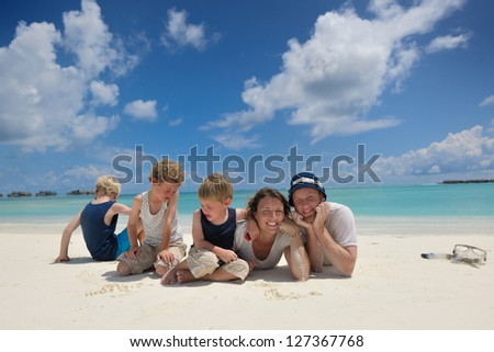 Portrait of a happy family on summer vacation  at beach
