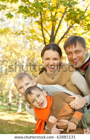 portrait of a happy family on the nature