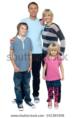 Portrait of a happy family on white background - stock photo