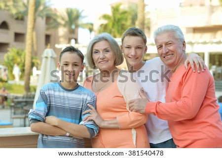Portrait of a happy family portrait on tropical resort - stock photo