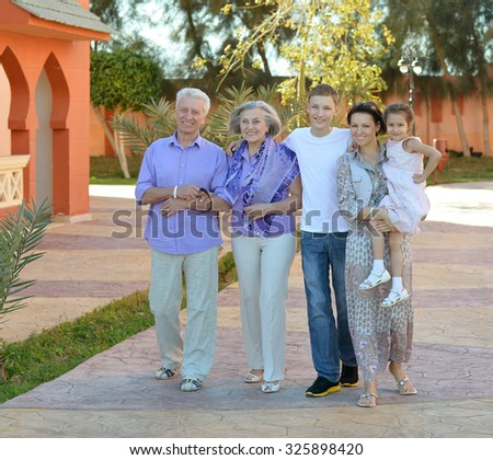 Portrait of a happy family relaxing at vacation resort - stock photo